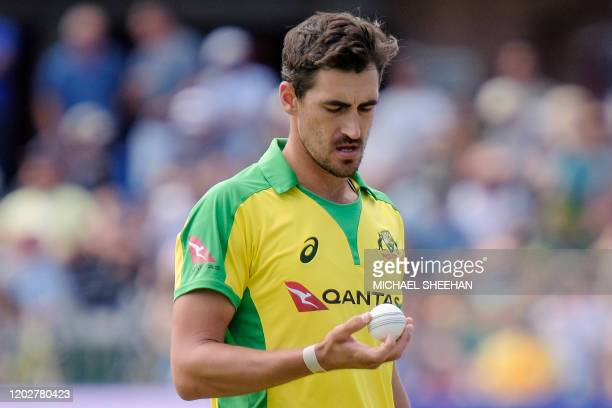 Mitchell Starc of Australia eyes the ball during the second Twenty20 International cricket match between South Africa and Australia at the St...