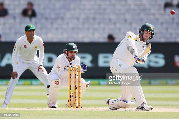 Mitchell Starc of Australia hits a six during day five of the Second Test match between Australia and Pakistan at Melbourne Cricket Ground on...