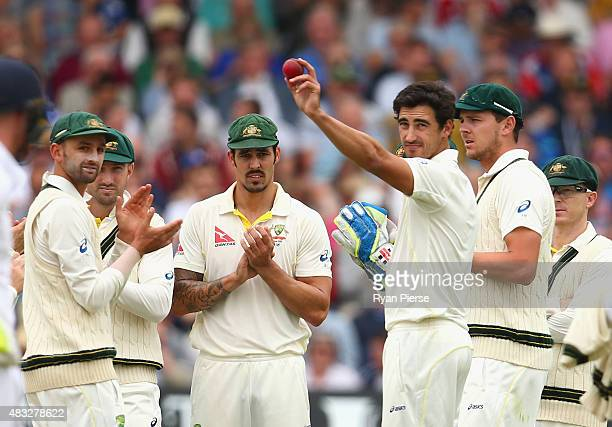 Mitchell Starc of Australia holds the ball aloft after claiming his fifth wicket of the innings during day two of the 4th Investec Ashes Test match...