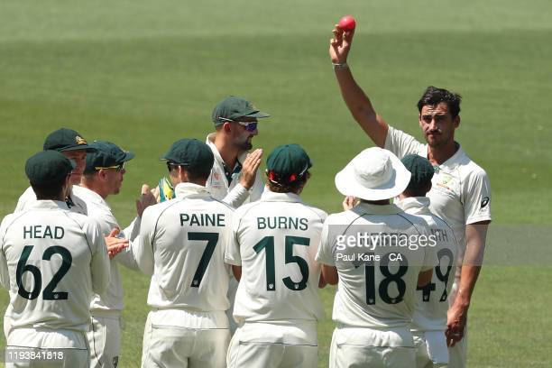 Mitchell Starc of Australia holds the ball aloft after taking his 5th wicket during day three of the First Test match in the series between Australia...