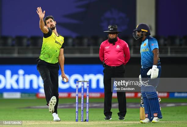 Mitchell Starc of Australia in bowling action during the ICC Men's T20 World Cup match between Australia and Sri Lanka at Dubai International Stadium...
