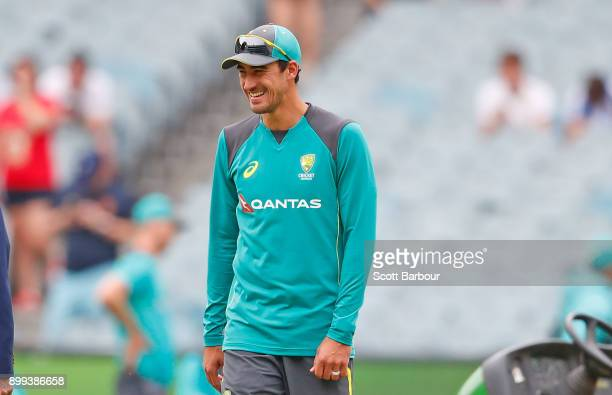 Mitchell Starc of Australia inspects the pitch during day four of the Fourth Test Match in the 2017/18 Ashes series between Australia and England at...