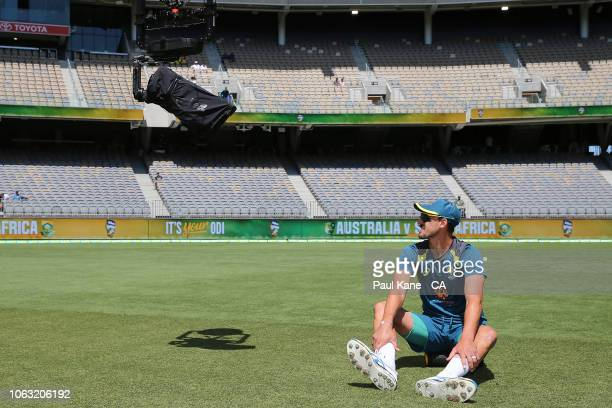 Mitchell Starc of Australia interacts with tv commentators via the Flying Fox camera while warming up before game one of the One Day International...