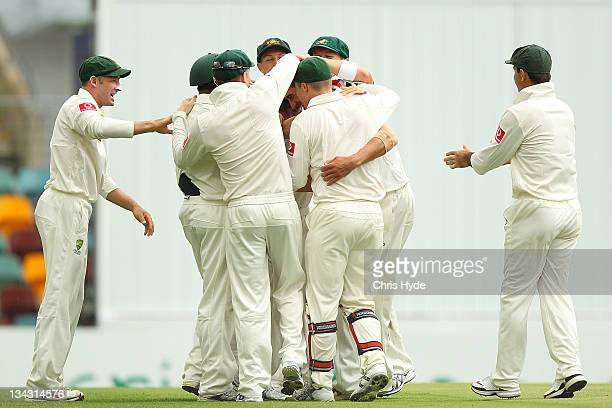 Mitchell Starc of Australia is congratulated by team mates after taking the wicket of Jesse Ryder of New Zealandduring day one of the First Test...