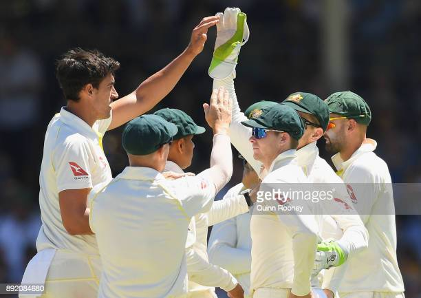 Mitchell Starc of Australia is congratulated by team mates after getting the wicket of Mark Stoneman of England during day one of the Third Test...