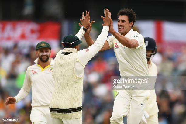 Mitchell Starc of Australia is congratulated by team mates after getting the wicket of James Vince of England during day four of the Third Test match...