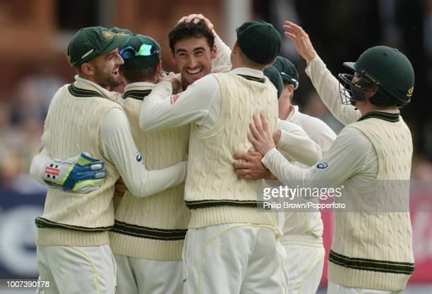 Mitchell Starc of Australia is congratulated by teammates after dismissing England opener Adam Lyth for 0 during the 2nd Ashes Test match between...