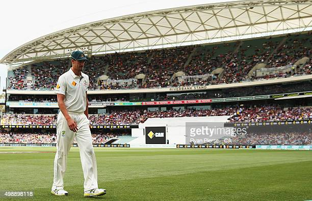 Mitchell Starc of Australia leaves the field injuired during day one of the Third Test match between Australia and New Zealand at Adelaide Oval on...