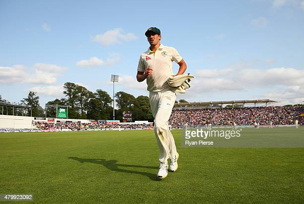 Mitchell Starc of Australia leaves the field with a leg injury during day one of the 1st Investec Ashes Test match between England and Australia at...