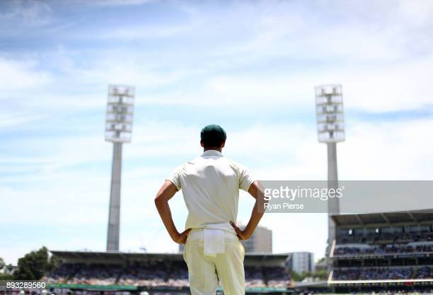 Mitchell Starc of Australia looks on during day two of the Third Test match during the 2017/18 Ashes Series between Australia and England at WACA on...