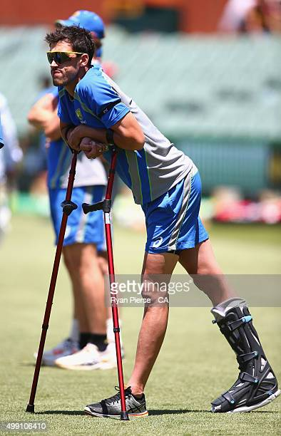 Mitchell Starc of Australia looks on in a protective boot and crutches during day three of the Third Test match between Australia and New Zealand at...