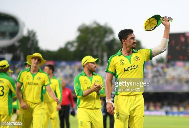 Mitchell Starc of Australia raises his cap to the crowd as he leaves the field after taking five wickets during the Group Stage match of the ICC...