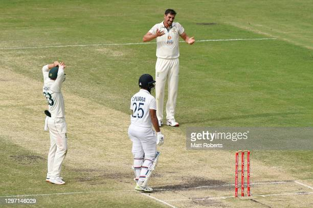 Mitchell Starc of Australia reacts during day five of the 4th Test Match in the series between Australia and India at The Gabba on January 19, 2021...