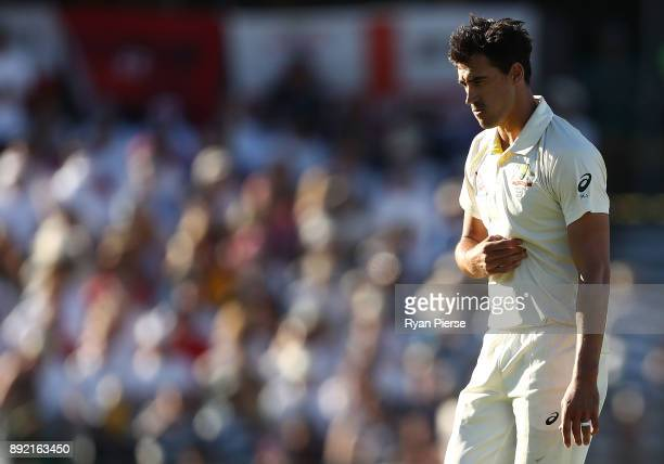 Mitchell Starc of Australia reacts while bowling during day one of the Third Test match of the 2017/18 Ashes Series between Australia and England at...