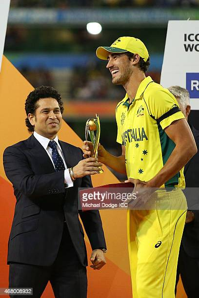 Mitchell Starc of Australia receives a trophy from Indian legend Sachin Tendulkar for being the best player of the tournament during the 2015 ICC...