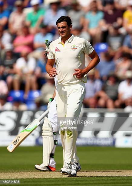 Mitchell Starc of Australia shows discomfort while bowling during day three of the 1st Investec Ashes Test match between England and Australia at...