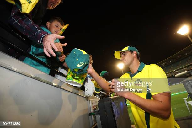 Mitchell Starc of Australia signs his autograph for fans during game one of the One Day International Series between Australia and England at...