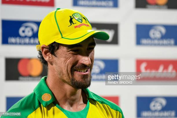 Mitchell Starc of Australia speaks with the press after receiving the award for 'man of the series' following the 3rd and final ODI between West...