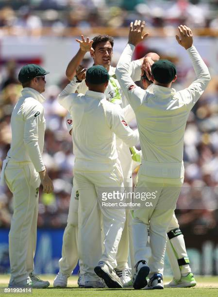 Mitchell Starc of Australia takes the wicket of Alastair Cook of England during day one of the Third Test match of the 2017/18 Ashes Series between...