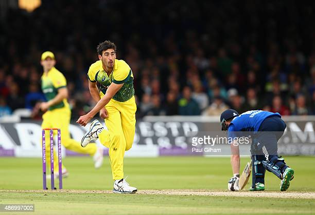 Mitchell Starc of Australia throws the ball at the wicket of Ben Stokes of England and the ball hits the hand of Ben Stokes who is subsequently given...