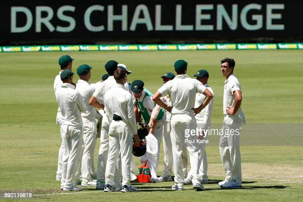 Mitchell Starc of Australia waits with team mates for the DRS Challenge dscision on Mark Stoneman of England during day one of the Third Test match...