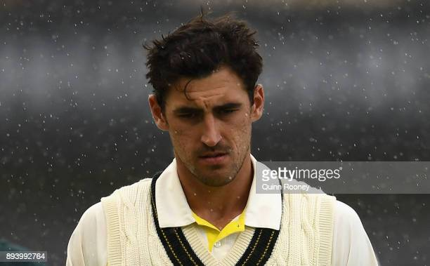 Mitchell Starc of Australia walks off the field as the rain falls during day four of the Third Test match during the 2017/18 Ashes Series between...