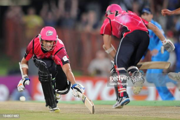 Mitchell Starc of Sydney Sixers dives to make the winning run during the Karbonn Smart CLT20 Semi Final match between Nashua Titans and Sydney Sixers...