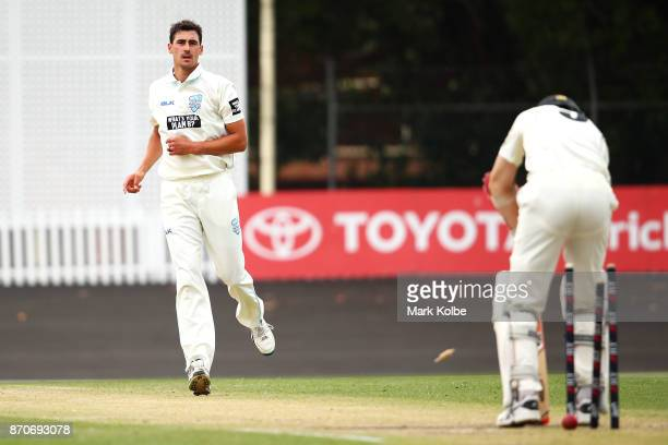 Mitchell Starc of the Blues bowls Jason Behrendorff of the Warriors to claim the first of his three wickets in his hattrick during day three of the...