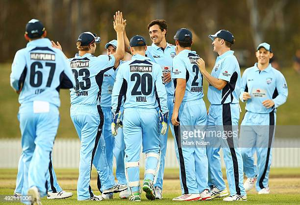 Mitchell Starc of the Blues celebrates a wicket with team mates during the Matador BBQs One Day Cup match between New South Wales and Western...