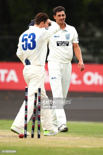Mitchell Starc of the Blues celebrates bowling Jason Behrendorff of the Warriors to claim the first of his three wickets in his hattrick during day...