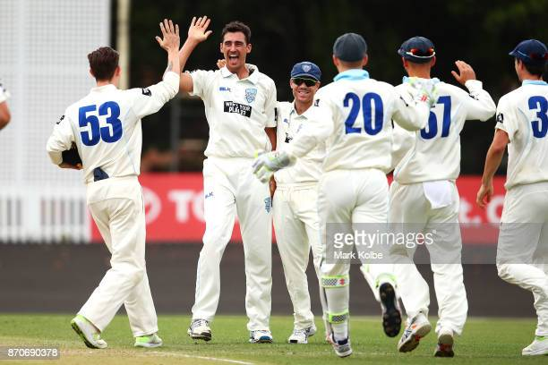 Mitchell Starc of the Blues celebrates with his Blues team after bowling Simon Mackin of the Warriors to take a hattrick during day three of the...