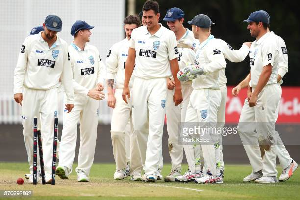 Mitchell Starc of the Blues looks at the stumps as he celebrates with his Blues team after bowling Simon Mackin of the Warriors to take a hattrick...