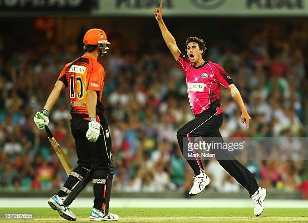 Mitchell Starc of the Sixers celebrates the wicket of Mitchell Marsh of the Scorchers during the T20 Big Bash League match between the Sydney Sixers...