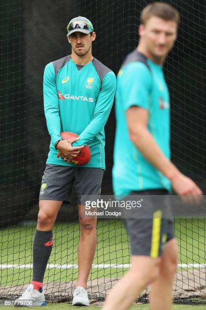 Mitchell Starc ruled out with injury looks on as possible replacement Jackson Bird walk across during an Australian nets session at the on December...