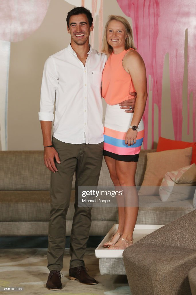 Mitchell Stark and Alyssa Healy, who hops up on the couch, pose at Crown Metropol after the Australian nets session on December 25, 2017 in Melbourne, Australia.