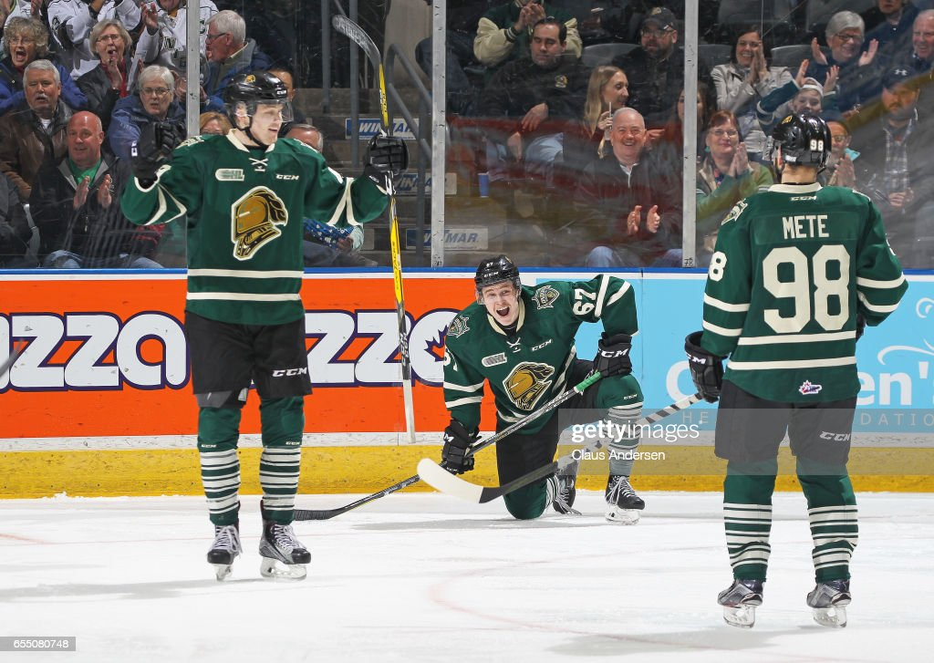 Mitchell Stephens #67 of the London Knights cannot believe the highlight reel goal his teammate Max Jones #49 has scored against the Flint Firebirds during an OHL game at Budweiser Gardens on March 17, 2017 in London, Ontario, Canada. The Knights defeated the Firebirds 7-3.