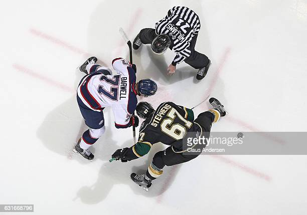 Mitchell Stephens of the London Knights takes a faceoff against Jesse Barwell of the Saginaw Spirit during an OHL game at Budweiser Gardens on...
