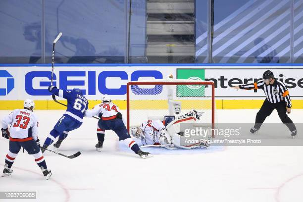 Mitchell Stephens of the Tampa Bay Lightning scores a goal past Braden Holtby of the Washington Capitals during the second period in Game One of the...