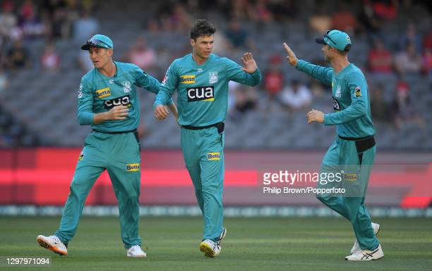 Mitchell Swepson is congratulated by Marnus Labuschagne and Joe Denly of Heat after the dismissal of Shaun Marsh during the Big Bash League match...