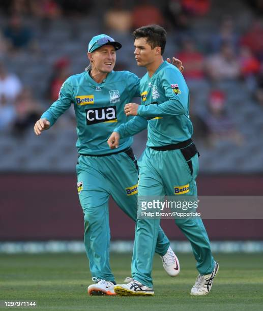 Mitchell Swepson is congratulated by Marnus Labuschagne of Heat after the dismissal of Shaun Marsh during the Big Bash League match between the...