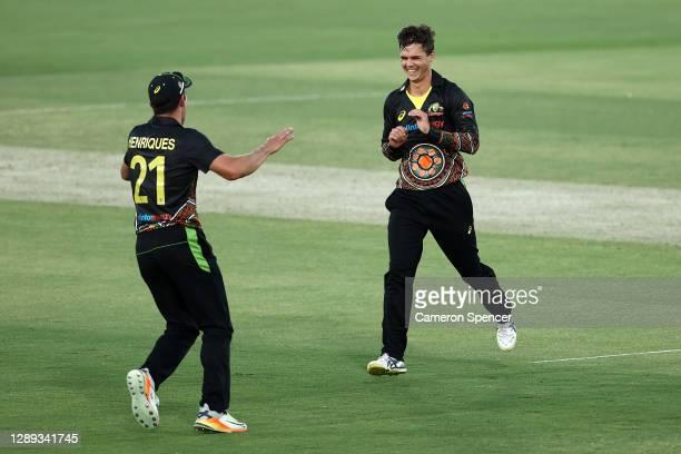 Mitchell Swepson of Australia celebrates dismissing Virat Kohli of India during game one of the Twenty20 International series between Australia and...