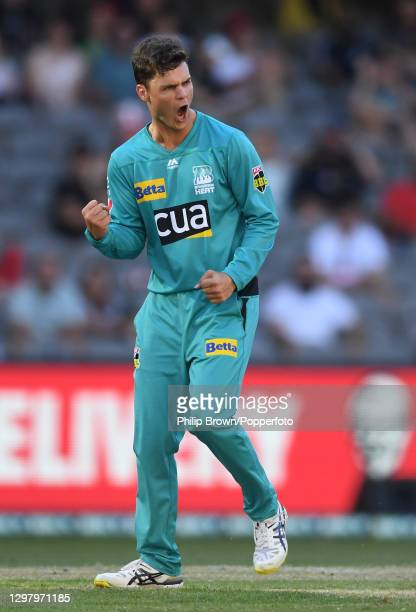 Mitchell Swepson of Heat celebrates the dismissal of Shaun Marsh during the Big Bash League match between the Melbourne Renegades and the Brisbane...