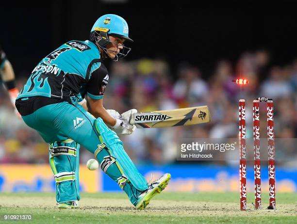 Mitchell Swepson of the Heat is bowled during the Big Bash League match between the Brisbane Heat and the Melbourne Renegades at The Gabba on January...