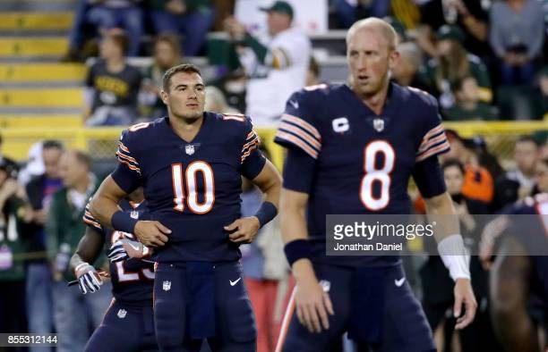 Mitchell Trubisky and Mike Glennon of the Chicago Bears warm up before the game against the Green Bay Packers at Lambeau Field on September 28 2017...