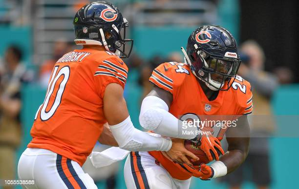 Mitchell Trubisky hands the ball off to Jordan Howard of the Chicago Bears in action against the Miami Dolphins at Hard Rock Stadium on October 14...