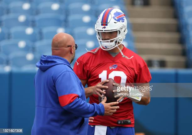 Mitchell Trubisky of the Buffalo Bills talks to offense coordinator Brian Daboll during OTA workouts at Highmark Stadium on June 2, 2021 in Orchard...