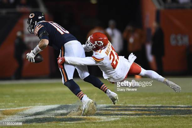 Mitchell Trubisky of the Chicago Bears avoids a tackle by Bashaud Breeland of the Kansas City Chiefs during a game at Soldier Field on December 22,...