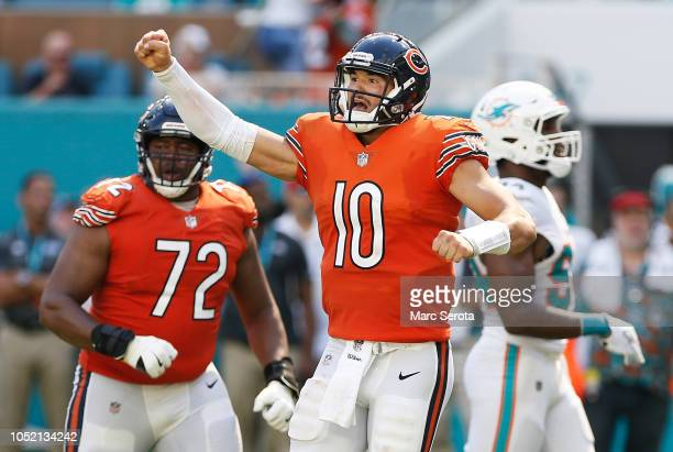 Mitchell Trubisky of the Chicago Bears celebrates after throwing a touchdown pass to Allen Robinson in the third quarter against the Miami Dolphins...
