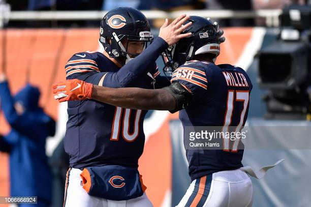 Mitchell Trubisky of the Chicago Bears celebrates with Anthony Miller of the Chicago Bears after scoring against the Detroit Lions at Soldier Field...