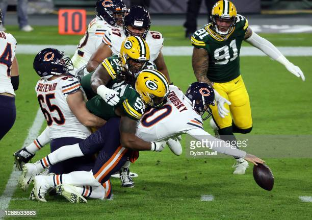 Mitchell Trubisky of the Chicago Bears fumbles the ball during the 1st half of the game against the Green Bay Packers at Lambeau Field on November...